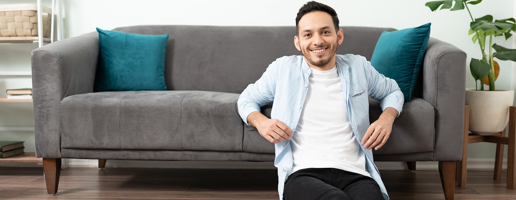 lifestyle image of a man in front of a couch